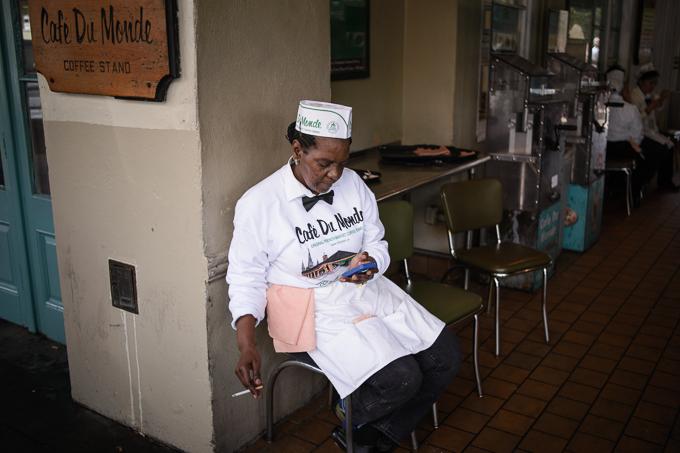street portrait of restaurant worker at Cafe Du Monde