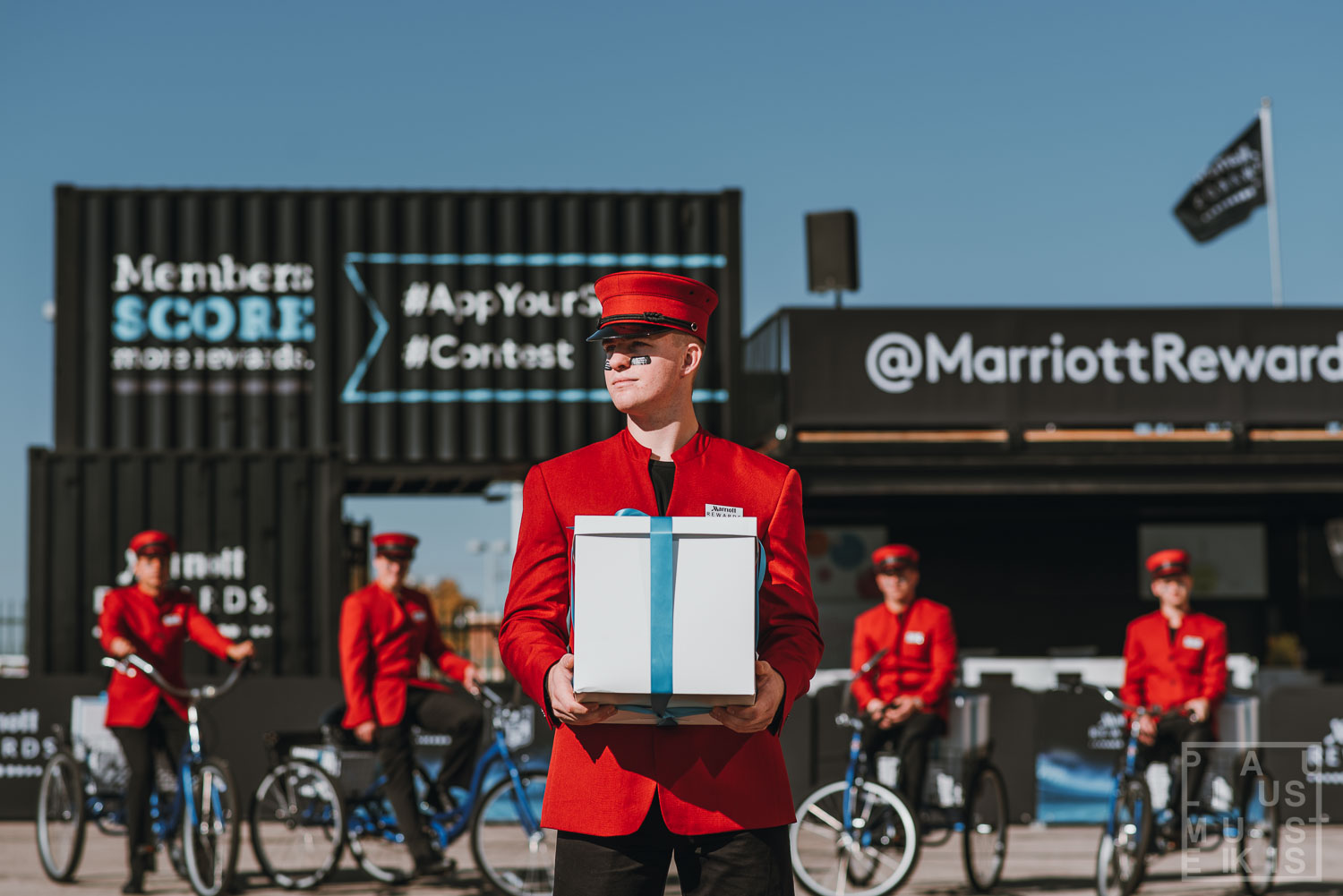 Men in red suits with gifts on bicycles during corporate event photography in Madison Wisconsin