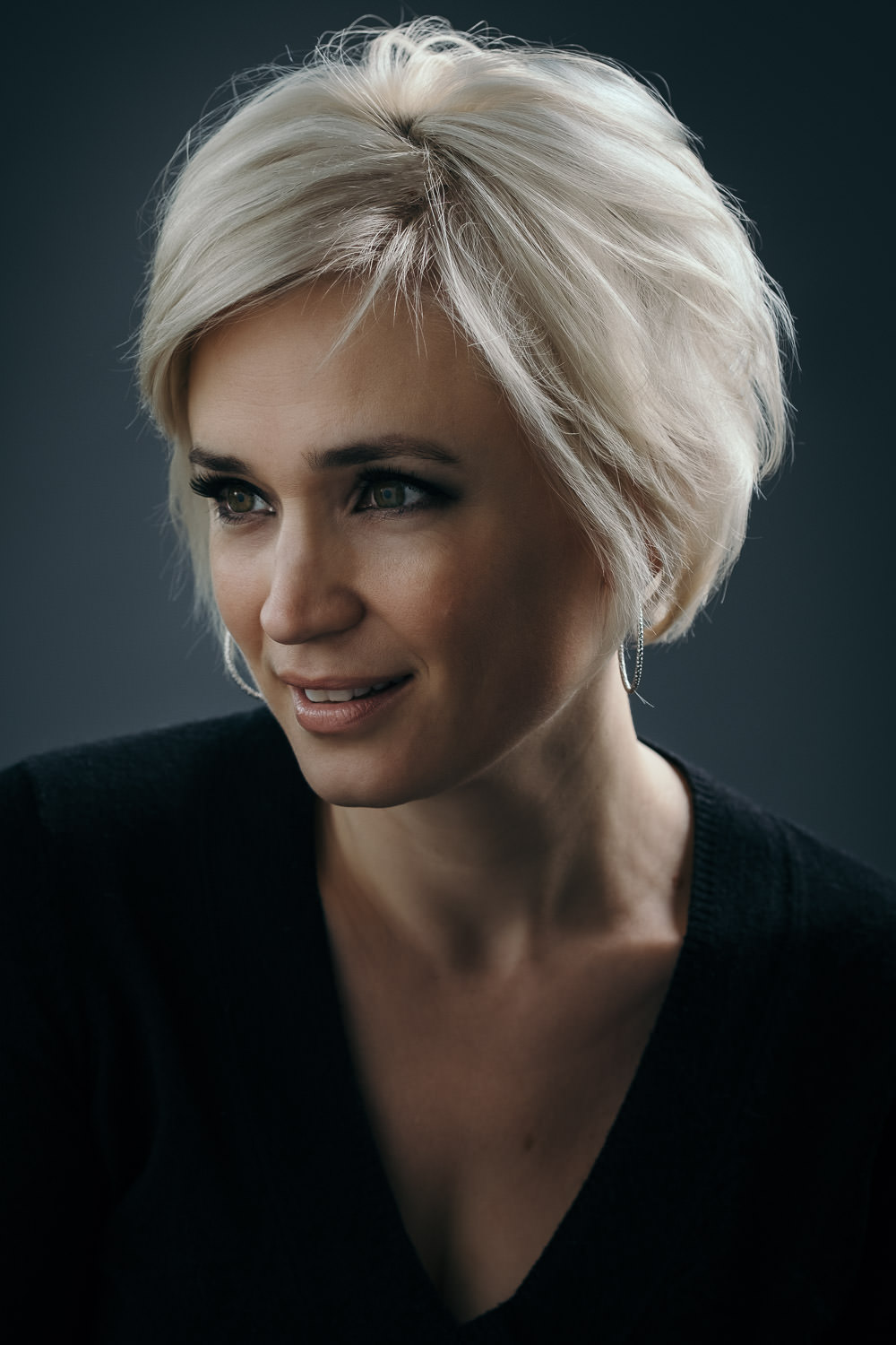 professional model headshot of a woman with a blonde hair in Madison Wisconsin photo studio