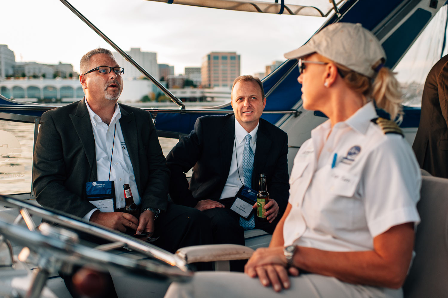 people talking with boat captain during corporate event