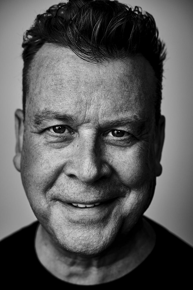 dramatic black and white business portrait of freelance writer and movie producer John Roach