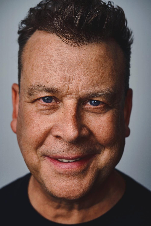 business headshot of an award-winning TV producer and director John Roach