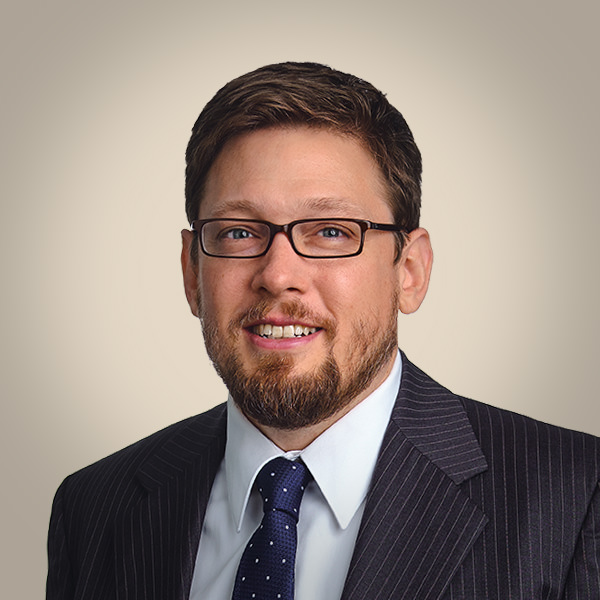 executive business headshot of a man in suit