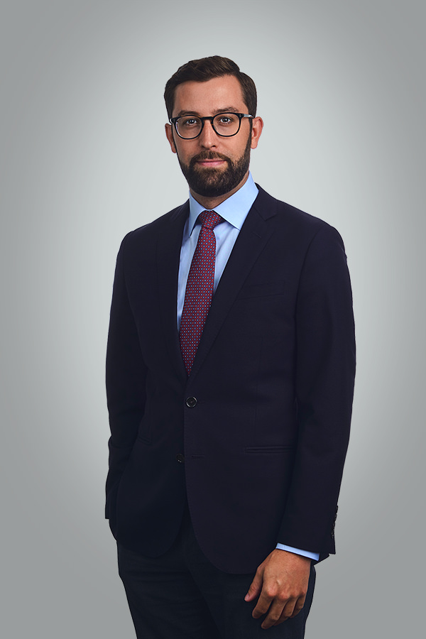 A business portrait of lawyer with a neutral grey background