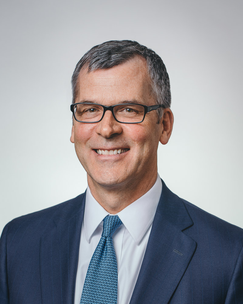 Business headshot of company's vice-president and wealth manager