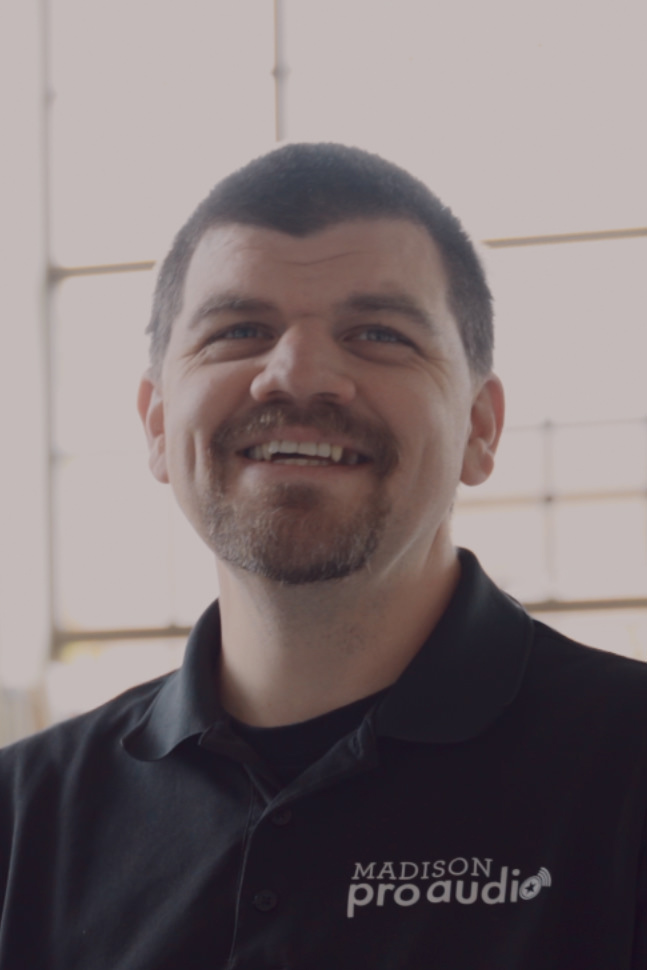 Snapshot of a smiling man from video testimonial