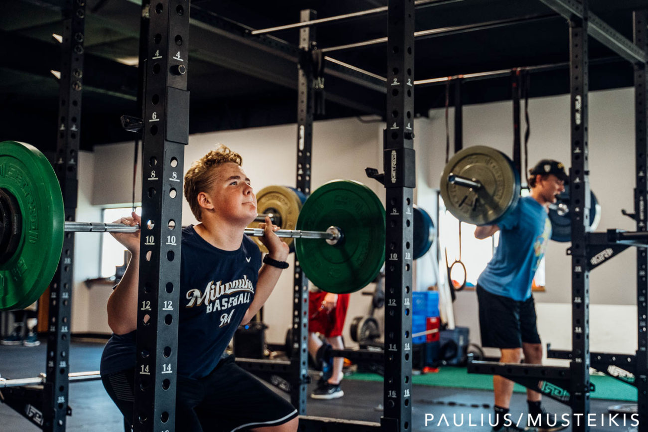 personal brand photography of student doing power lifting in Madison, WI