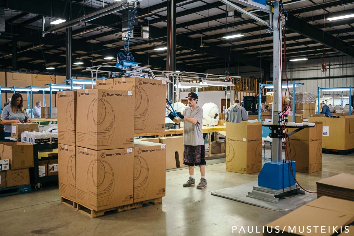 Business photography of an employee lifting boxes